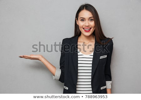 Portrait of a smiling woman holding copyspace on the palm Stock photo © deandrobot
