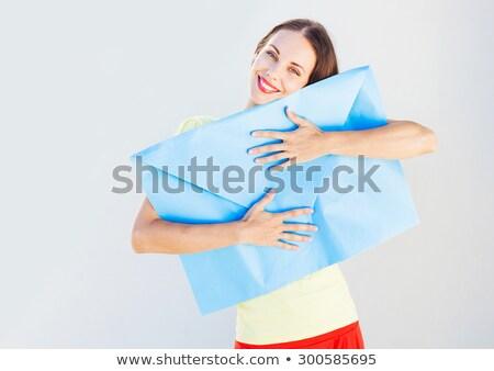 smiling business woman holding a big envelope stock photo © rastudio