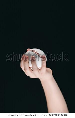partial view of kid holding baseball ball isolated on black Stock photo © LightFieldStudios