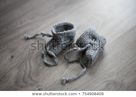 Small baby in knitted clothes Stock photo © tekso