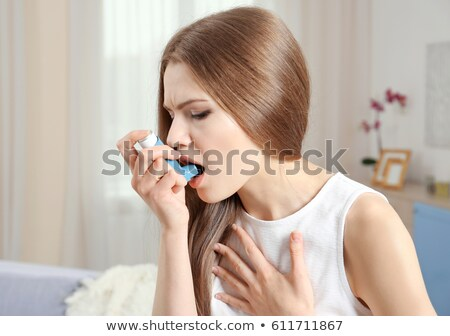 woman using asthma inhaler at home stock photo © wavebreak_media