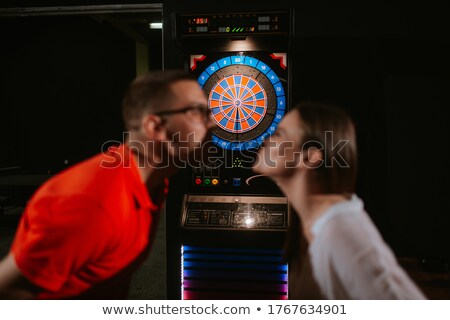 couple leaning over table kissing Stock photo © IS2