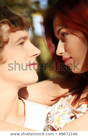 Couple strolling gazing at each other Stock photo © IS2