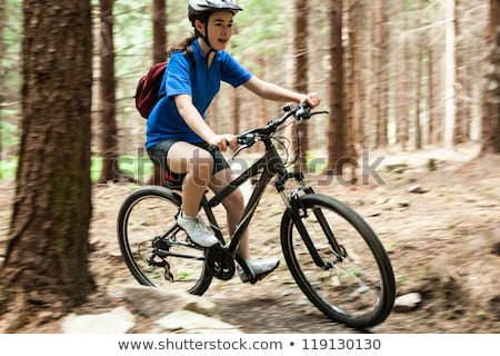 Female mountain biker riding bicycle in the forest Stock photo © wavebreak_media
