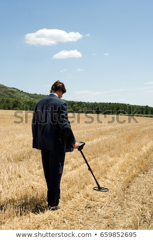 businessman with metal detector outdoors stock photo © is2