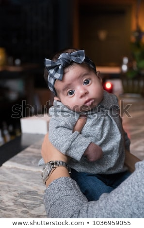 Woman holding baby up on kitchen counter Stock photo © IS2