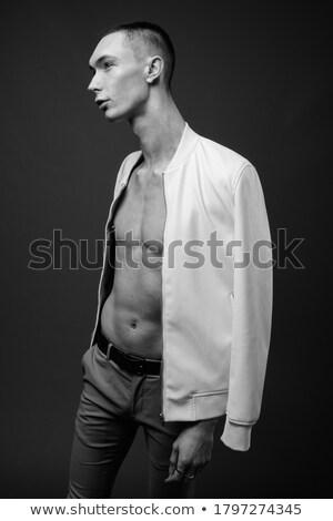 Androgynous man against grey background Stock photo © wavebreak_media