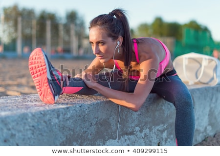 Flexible woman training on a beach Stock photo © konradbak