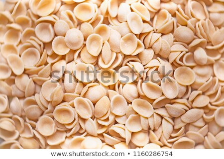 raw uncooked italian orecchiette pasta food background blur defocused  Stock photo © zkruger
