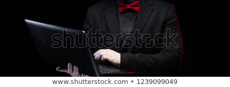 Portrait of confident handsome ambitious elegant responsible businessman boxing on black background Stock photo © Traimak