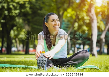happy young woman doing sports outdoors Stock photo © dolgachov
