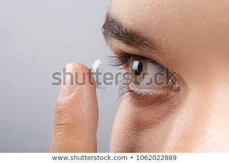 Dedo lente de contato transparente homem olhos Foto stock © AndreyPopov