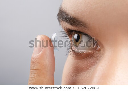 Dedo lente de contacto primer plano transparente hombre ojos Foto stock © AndreyPopov
