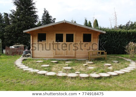Scene with wood cabin in the garden Stock photo © colematt