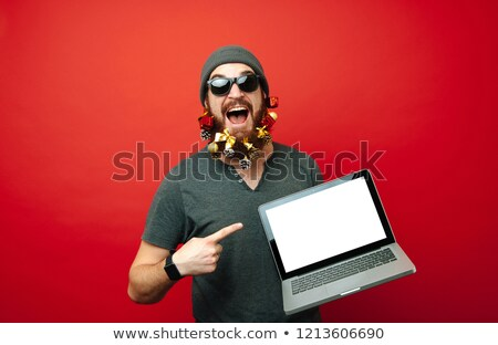portrait of santa holding tablet and pointing finger Stock photo © feedough