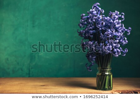 purple flowers with green stems on a wood Stock photo © ruslanshramko
