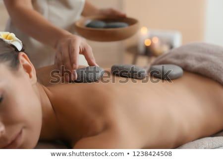 mulher · jovem · quente · pedra · massagem · belo · ombro - foto stock © boggy