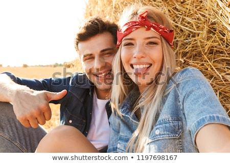 Felice seduta campo di grano Foto d'archivio © deandrobot