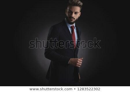 Retrato curioso empresário olhando para baixo lado terno Foto stock © feedough