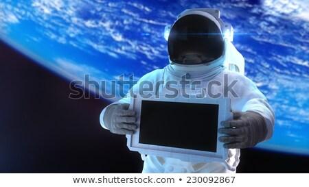 Three astronauts flying in space Stock photo © colematt