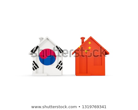 two houses with flags of china and south korea stock photo © mikhailmishchenko
