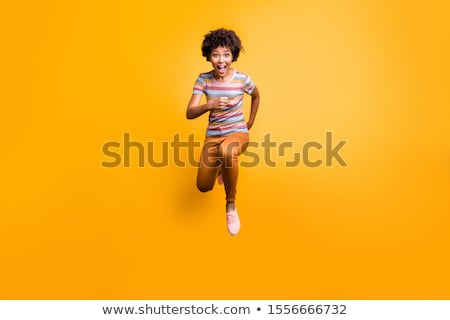 Surprised Fashion model Girl full length jump. Beautiful young woman posing in studio, emotions Stock photo © studiolucky