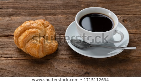 Cup of cappuccino coffee and croissants on a wooden table Stock photo © boggy