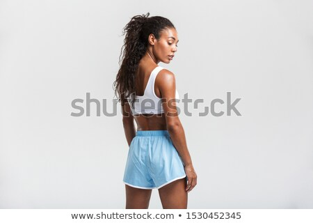 back view portrait of a pretty young african sportswoman stock photo © deandrobot