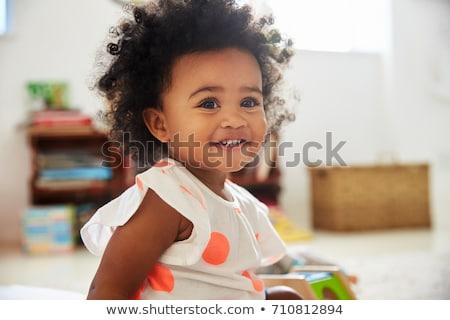 happy baby girl sitting on floor at home stock photo © dolgachov