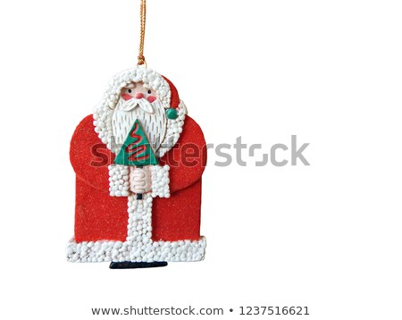 Pendant or Christmas tree toy in the form of an old man in a turban isolated on white background. Ve Stock photo © Lady-Luck