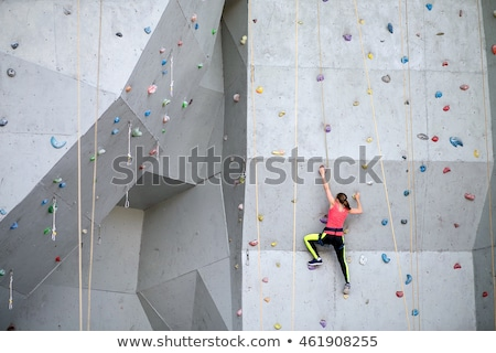 Athletic people practicing rock wall climbing Stock photo © Kzenon