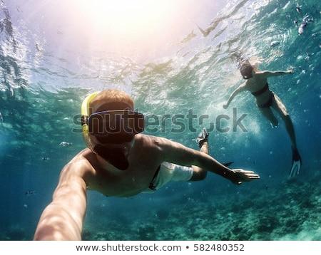Paar mensen snorkelen onderwater zwemmen Stockfoto © robuart