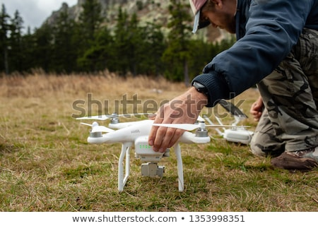 Handsome young man flying a drone outdoors  Stock photo © lightpoet