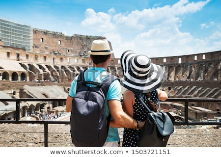 young couple standing inside of colosseum stock photo © andreypopov