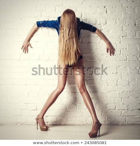 Városi lány stúdió pózol hozzáállás divat Stock fotó © Lopolo