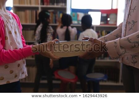 Középső rész női tanár könyv iskolás lány könyvtár Stock fotó © wavebreak_media