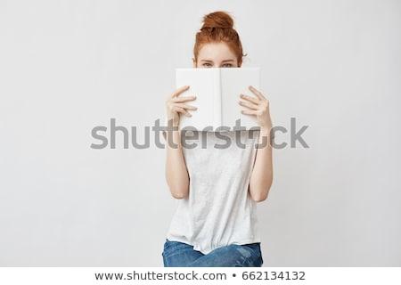 Tini diák lány rejtőzködik mögött jegyzetfüzetek Stock fotó © dolgachov