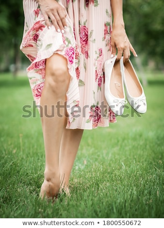 Barefoot young woman in green meadow; Harmony with nature Stock photo © lightpoet
