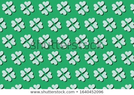 Handcraft paper green clover's four petals. Stock photo © artjazz
