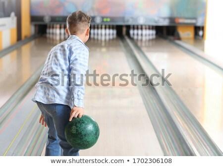 Küçük erkek oynama bowling el gülümseme Stok fotoğraf © Lopolo