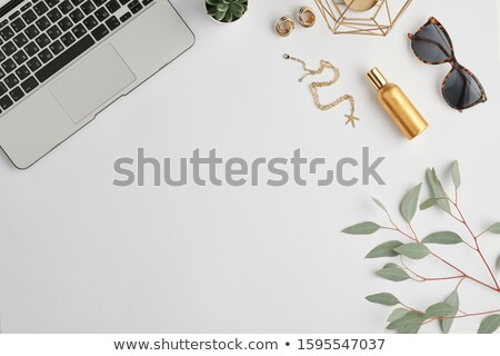 Stylish sunglasses, bottle of scent, golden earrings and chain and other stuff Stock photo © pressmaster