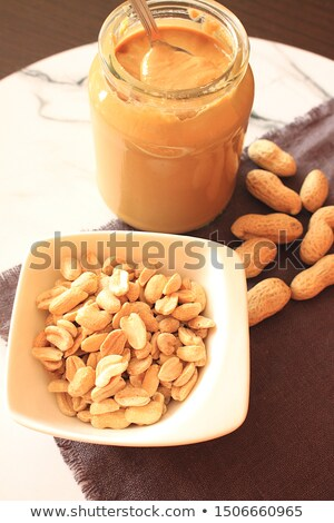 Few unshelled almonds Stock photo © digitalr