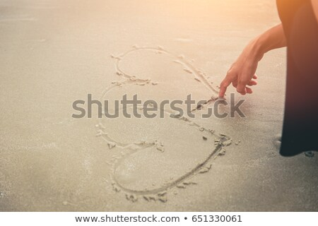 heart drawing on sea sand stock photo © ozaiachin