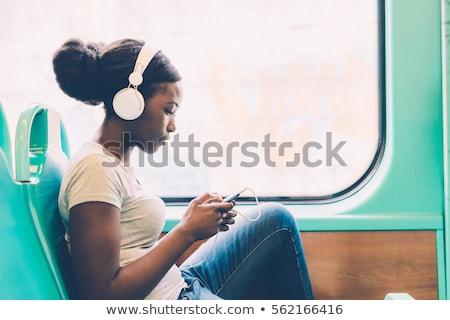 sério · olhando · mulher · ouvir · música · branco · música - foto stock © Rob_Stark