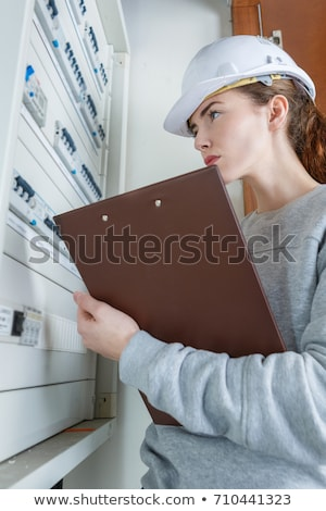 female electrician checking fuse box stock photo © photography33