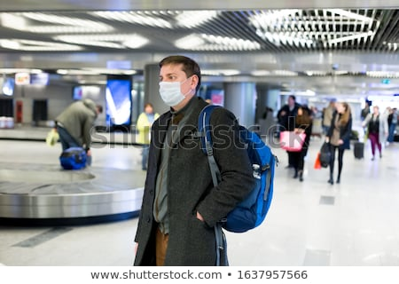 a man spreading a coating Stock photo © photography33