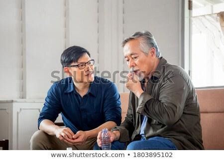 Elderly man taking medication Stock photo © photography33