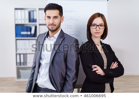 sucessful businesswoman posing with folded arms stock photo © stockyimages