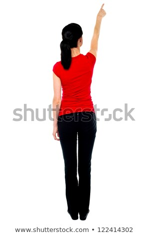 Back pose of woman in casuals pointing away Stock photo © stockyimages