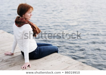 Woman contemplating life by the water's edge Stock photo © photography33